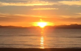 Walk the beach at sunrise